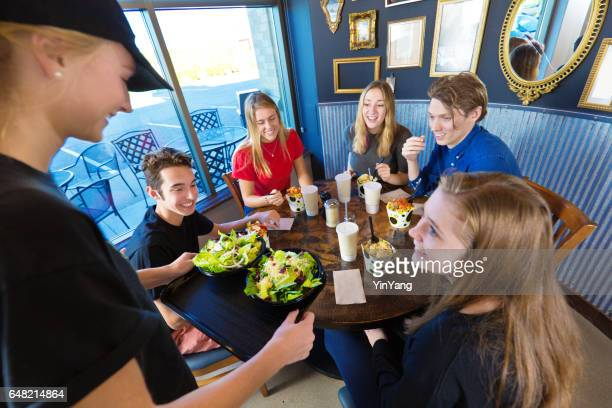 Wait Staff Serving Customers in Casual restaurant