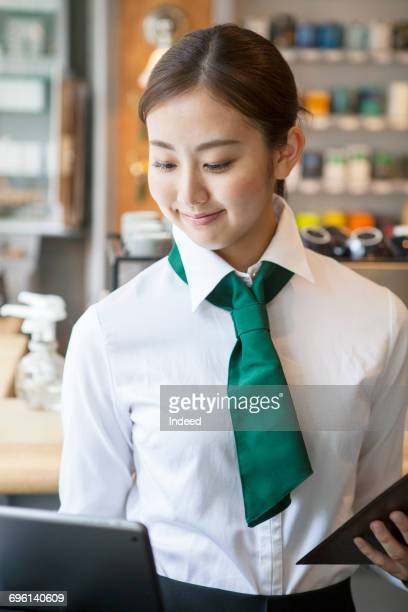 Wait staff using touch screen computer at restaurant