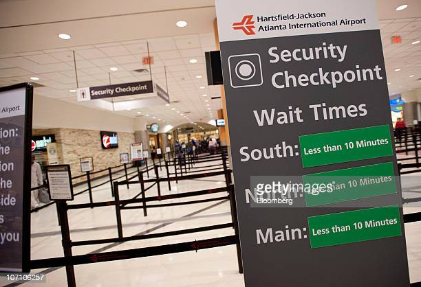 Wait times are displayed on a sign at the security checkpoint area at HartsfieldJackson International Airport in Atlanta Georgia US on Wednesday Nov...