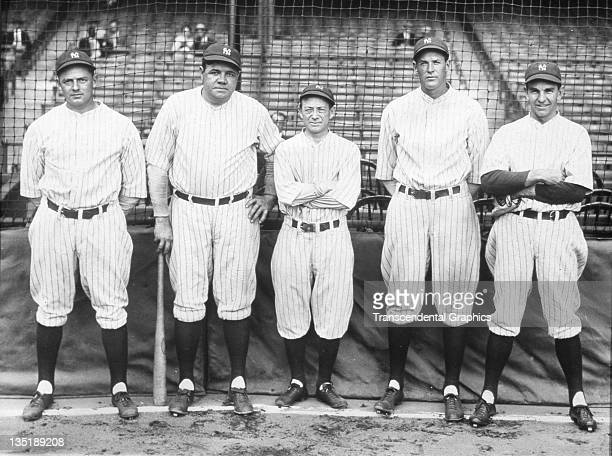Waite Hoyt, Babe Ruth, Huggins, Miller Huggins, Bob Meusel, and Bob Shawkey pose for a photo at Yankee Stadium in New York City in 1927.