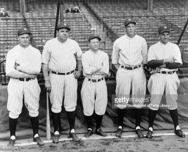 Waite Hoyt, Babe Ruth, manager Miller Huggins, Bob Meusel and Bob Shawkey of the New York Yankees pose for a photo circa 1921-1927.