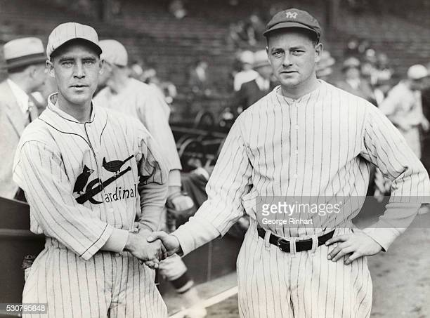 Waite Hoyt of the Yankees and Bill Sheriel of the Cardinals shake hands before the start of the first game of the series.