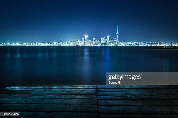 waitemata harbor at night seen from bayswater, auckland, north island, new zealand - auckland stock pictures, royalty-free photos & images