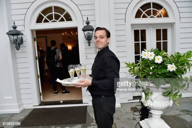 Waiter at the Katrina and Don Peebles Host NY Mission Society Summer Cocktails at Private Residence on July 7 2017 in Bridgehampton New York
