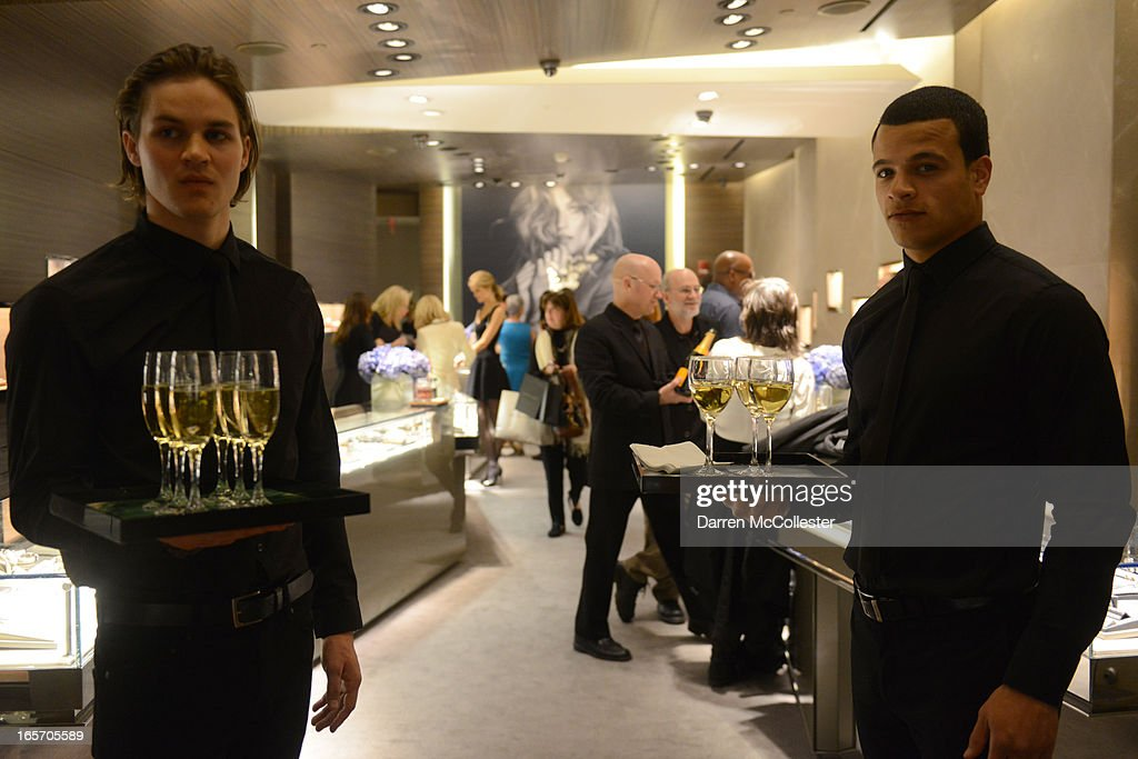 A waiter carries glasses of wine during the David Yurman Boston Dreaming In Color Shopping Event at David Yurman on April 4, 2013 in Boston, Massachusetts.