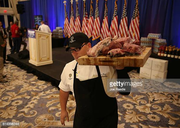A waiter carries Trump meat before Republican presidenital candidate Donald Trump was scheduled to appear for a press conference at the Trump...