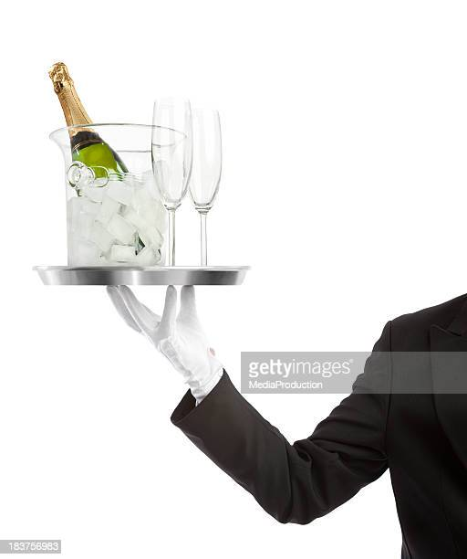 Waiter carrying a bottle of Champaigne with flutes