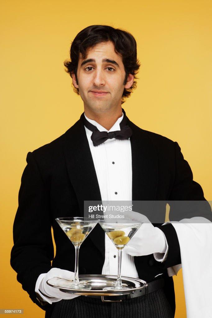 waiter-carrying-drinks-on-silver-platter