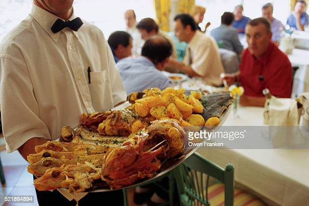 Waiter Carrying Platter of Food