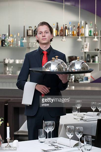 waiter carrying serving tray in restaurant XXXL image