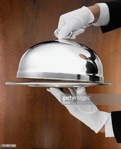 waiter carrying serving tray - dome stock pictures, royalty-free photos & images