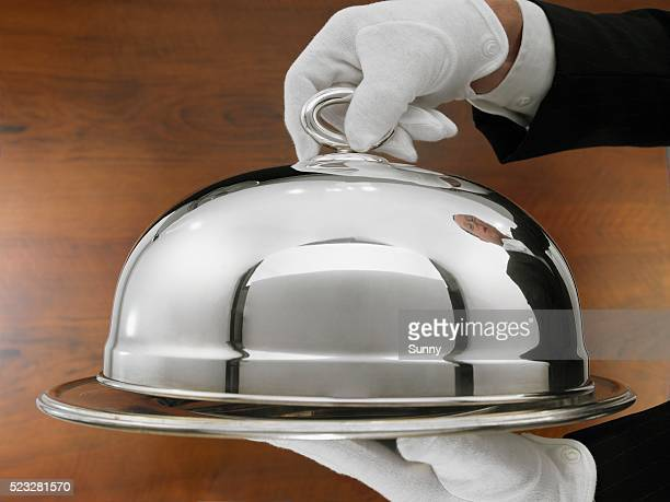 waiter carrying serving tray - serving food and drinks stock pictures, royalty-free photos & images