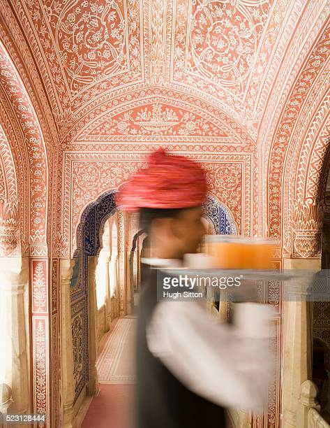 waiter carrying tray in ornate room - hugh sitton stock-fotos und bilder