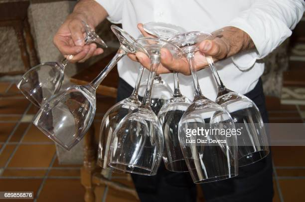 Waiter carrying wine glasses