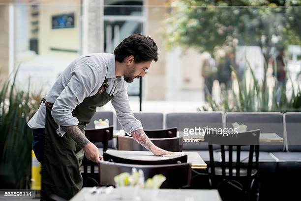Waiter cleaning tables at a restaurant