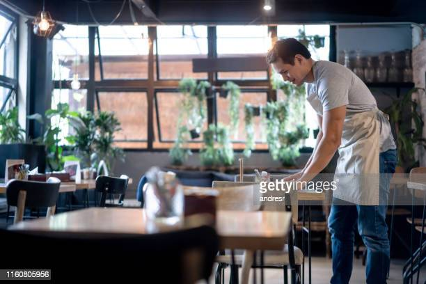 waiter cleaning up at a restaurant - wait staff stock pictures, royalty-free photos & images