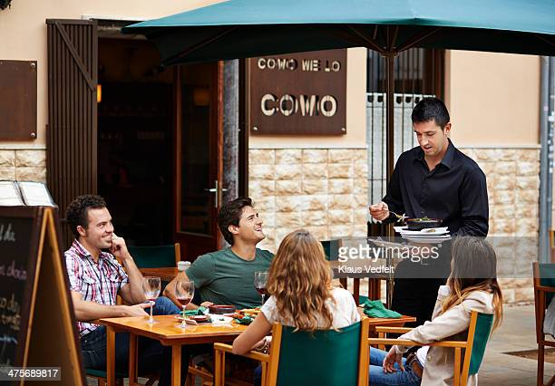 waiter clearing the table at restaurant - klaus vedfelt mallorca stock pictures, royalty-free photos & images