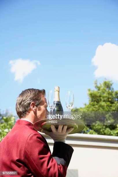Waiter delivering champagne