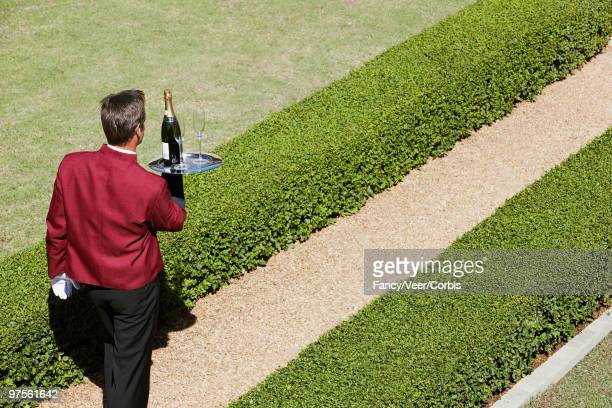 Waiter delivering champagne
