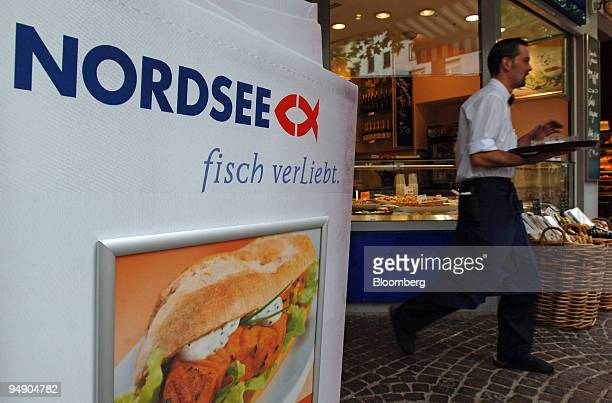 A waiter delivers food at a Nordsee restaurant in Frankfurt Germany Wednesday August 10 2005