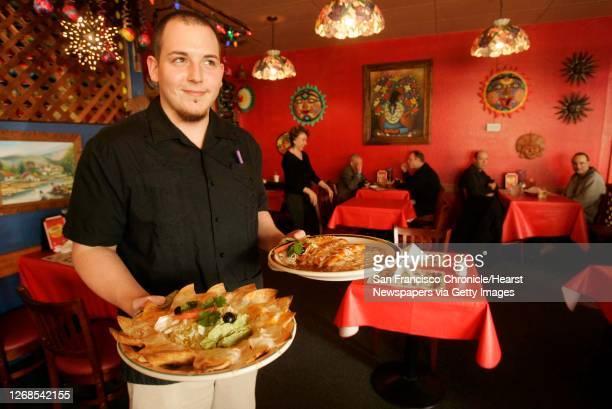 Waiter, Eduardo Velasco, serves lunch.Casa Lupe in Mountain View makes excellent enchiladas rojas and verdes.Bargain Bite running in 96Hours on Feb....