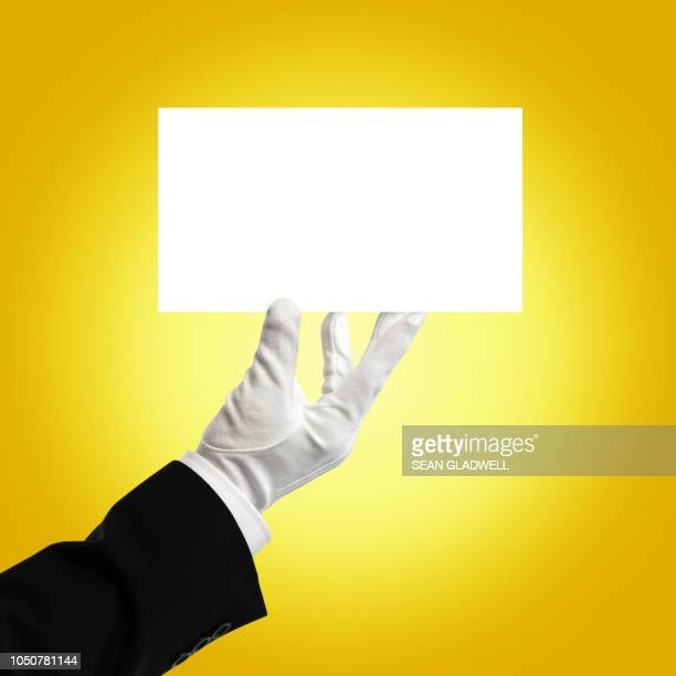waiter holding blank card - upper class stock pictures, royalty-free photos & images