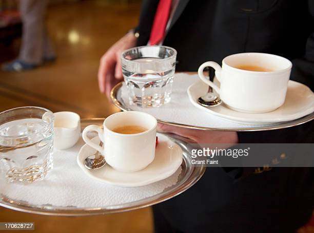 Waiter holding coffee trays