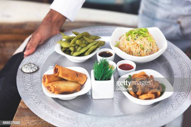 Waiter Holding Fresh Food Platter