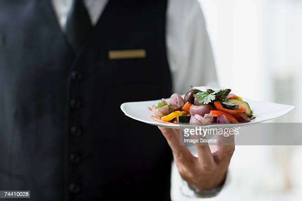waiter holding plate - wait staff stock pictures, royalty-free photos & images
