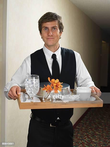 Waiter holding room service tray
