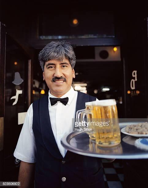 waiter holding tray of drinks - hugh sitton stock-fotos und bilder