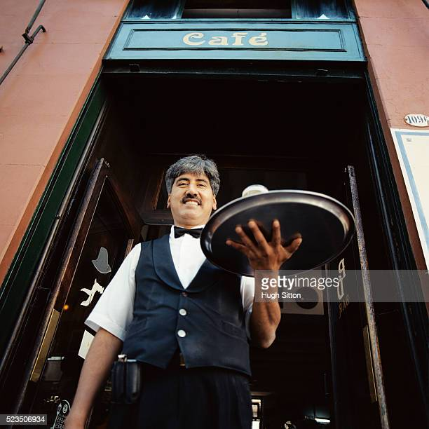 waiter holding tray of drinks - hugh sitton stock pictures, royalty-free photos & images