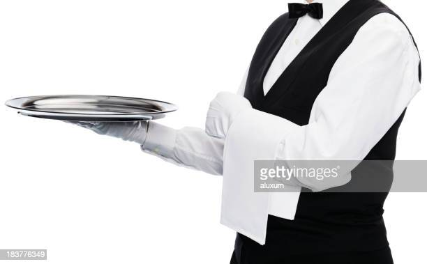 A waiter holding up an empty tray