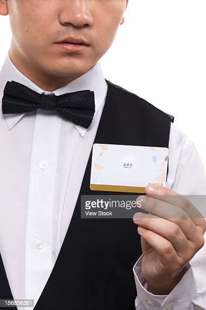 Waiter holding VIP card