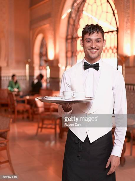 waiter in exotic cafe - トレイ ストックフォトと画像