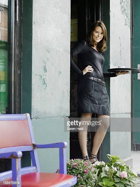 waiter in front of cafe - トレイ ストックフォトと画像