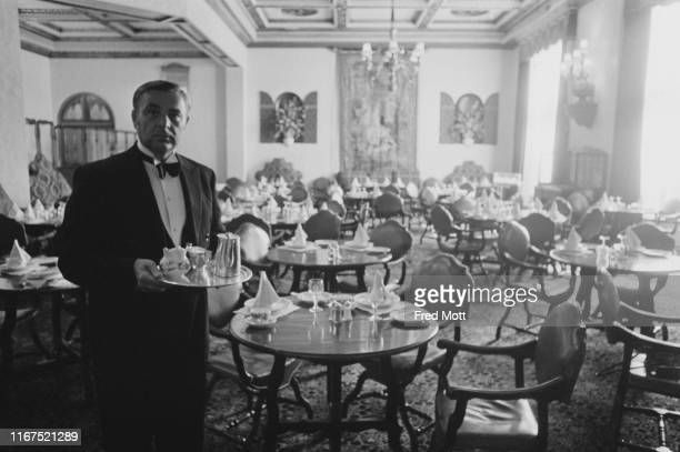 Waiter in the dining area of The Dorchester, London, UK, 22nd June 1976.