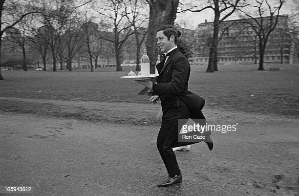 Waiter John Romano of the Grosvenor House Hotel practising in Hyde Park for the Waiters' race which will open the annual Soho Fair London 31st March...