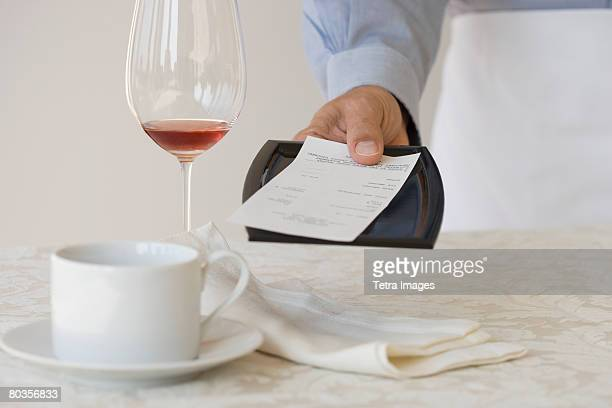 Waiter leaving check on table