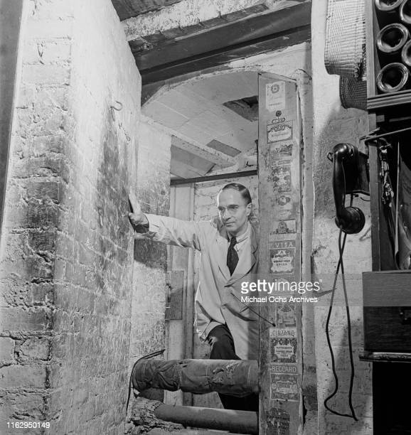 A waiter leaving the wine cellar at the 21 Club restaurant and speakeasy on West 52nd Street in New York City US September 1945