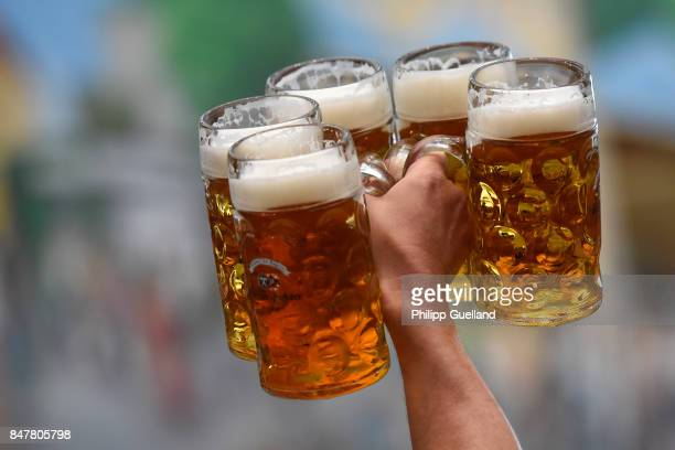A waiter lifts mugs of beer in the Hacker Pschorr tent on the first day of the 2017 Oktoberfest beer fest on September 16 2017 in Munich Germany...