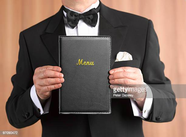 Waiter maitre d' with menu in front
