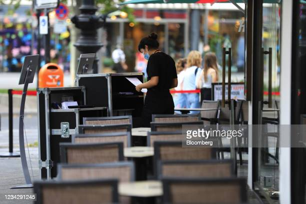 Waiter on an empty restaurant terrace in Berlin, Germany, on Thursday, July 29, 2021. Germany reports gross domestic product figures on July 30....