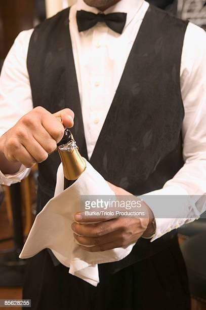 Waiter opening champagne
