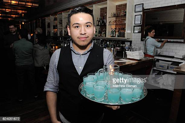 """Waiter passes cocktails at the afterparty for the New York premiere of """"Swim Team"""" at DOC NYC on November 17, 2016 in New York City."""