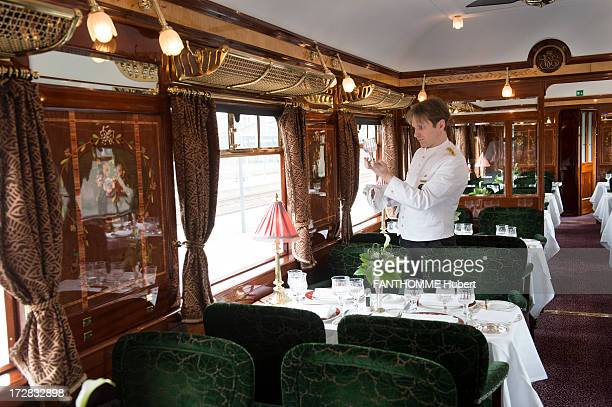 A waiter polishes a glass on the Venice Simplon Orient Express train on February 28 2013 at the Gare De L'Est Station in Paris The train refurbished...