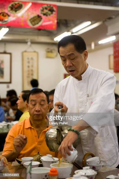 Waiter pouring tea, Lin Heung tea house, Central