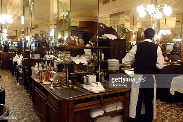 A waiter prepares a bill at the French restaurant Terminus Nord in Paris France Monday May 28 2007 Terminus Nord is a handy first stop for travelers...