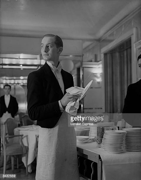 Waiter prepares the tables in a restaurant.