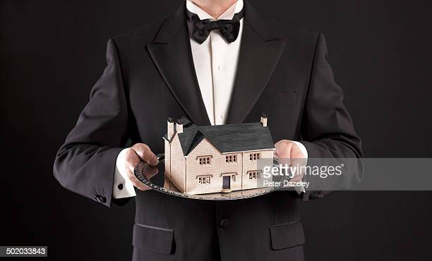 Waiter presenting auctioned house